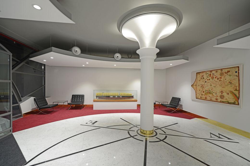 Interior of the new building with compass floor design Photo: Yerbury Press