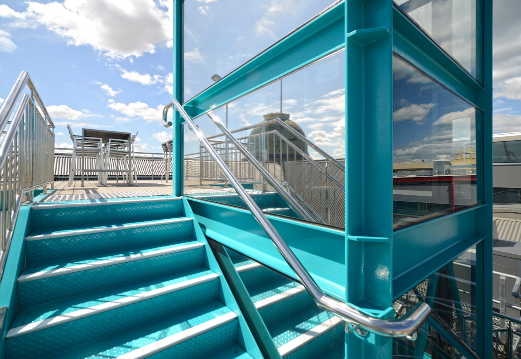 Glass lift shaft opening on to the skydeck Photo: Yerbury Press