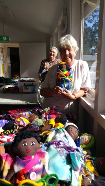 Doris Van Keulen and Jill Bygott happily packing dolls for lifeline in KwaZuluNatal