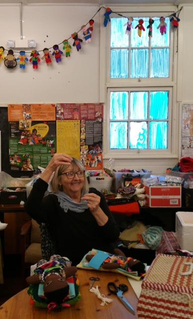 Rae Terlecki making final adjustments to the Uthando Dolls.