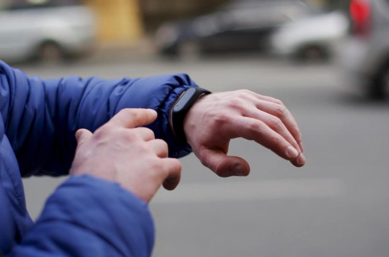 Person looking at Fitbit device on wrist