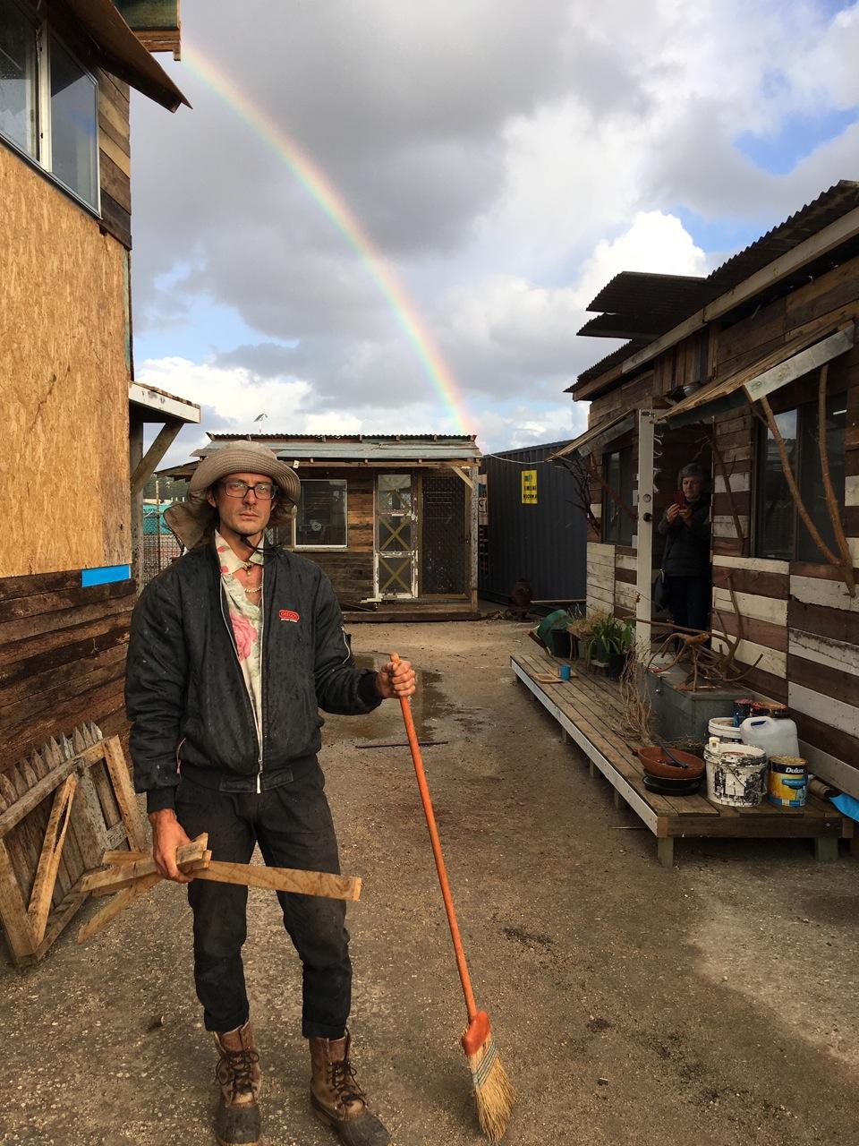 Jessee under a rainbow at his resort