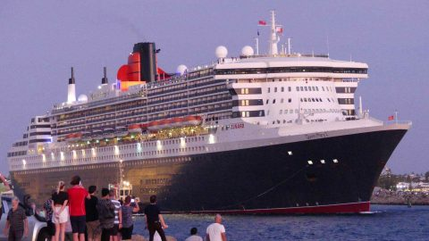 Seen Leaving Port – QM2 and Her Many Admirers