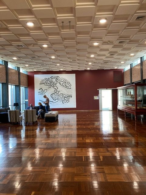 Local wandoo and jarrah parquetry flooring in foyer - inlaid with brass. Portunas artwork in back ground by Howard Taylor